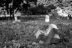 Abandoned_graves_by_amiev_at_flickr